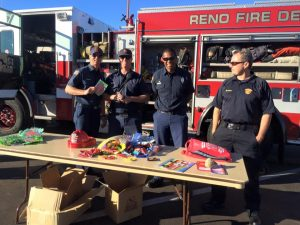 Fire fighters at a family health festival. Photo courtesy of TMHC.